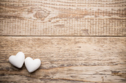 White heart and wooden background.